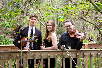 String Trio poses on boardwalk at Langford Park in Orlando, Florida