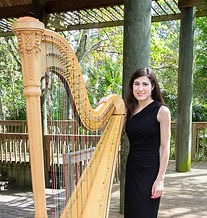 Harpist Haley Rhodeside poses with Harp at gazebo in Langford Park near downtown Orlando, Florida