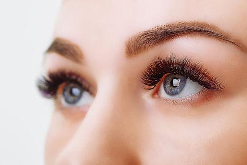 eyelash-extension-procedure-woman-eye-wi