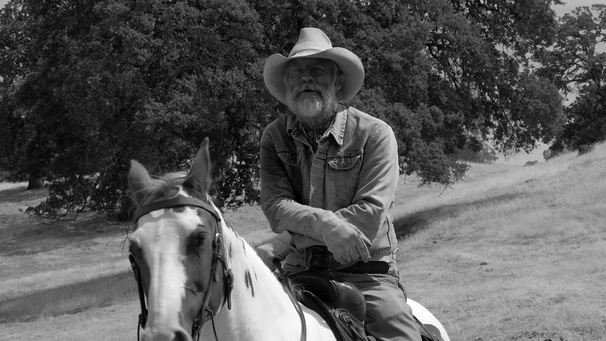 Perry King as Sam Kincaid in The Divide. Released in 2017 The Divide is a black and white, western drama shot in California.