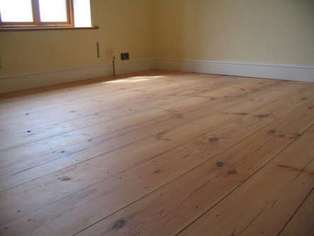 Lose tongues pitch pine floor made from reclaimed beams, Midsomer Norton