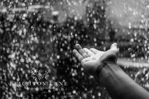 rain with hand stretched out