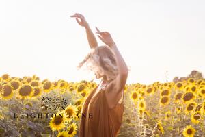 lady in sunflower field