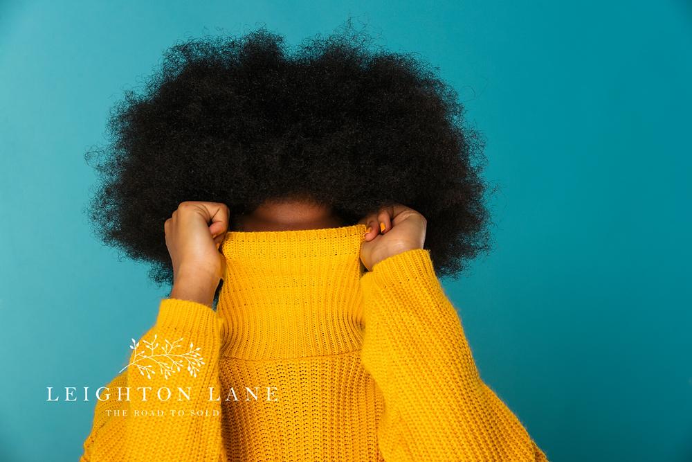 lady hiding in sweater