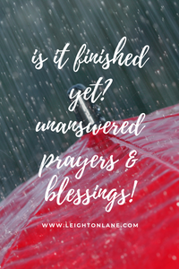 rain with red umbrella and quote