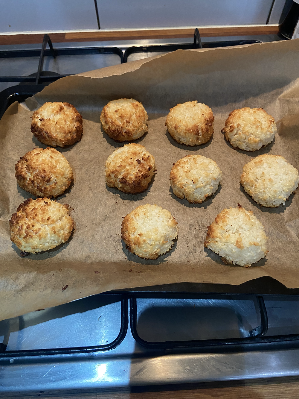 Freshly baked golden coconut macaroons straight out of the oven