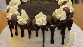 Vanilla birthday cake with strawberry jam & vanilla buttercream filling and a chocolate drip layer