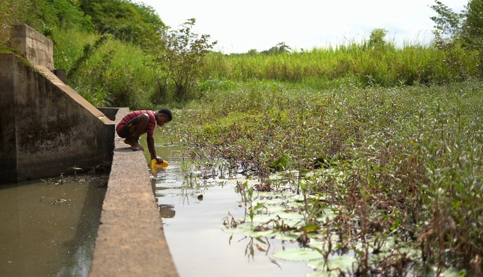 Fetching Dirty Water At Dam-Ghana.jpg