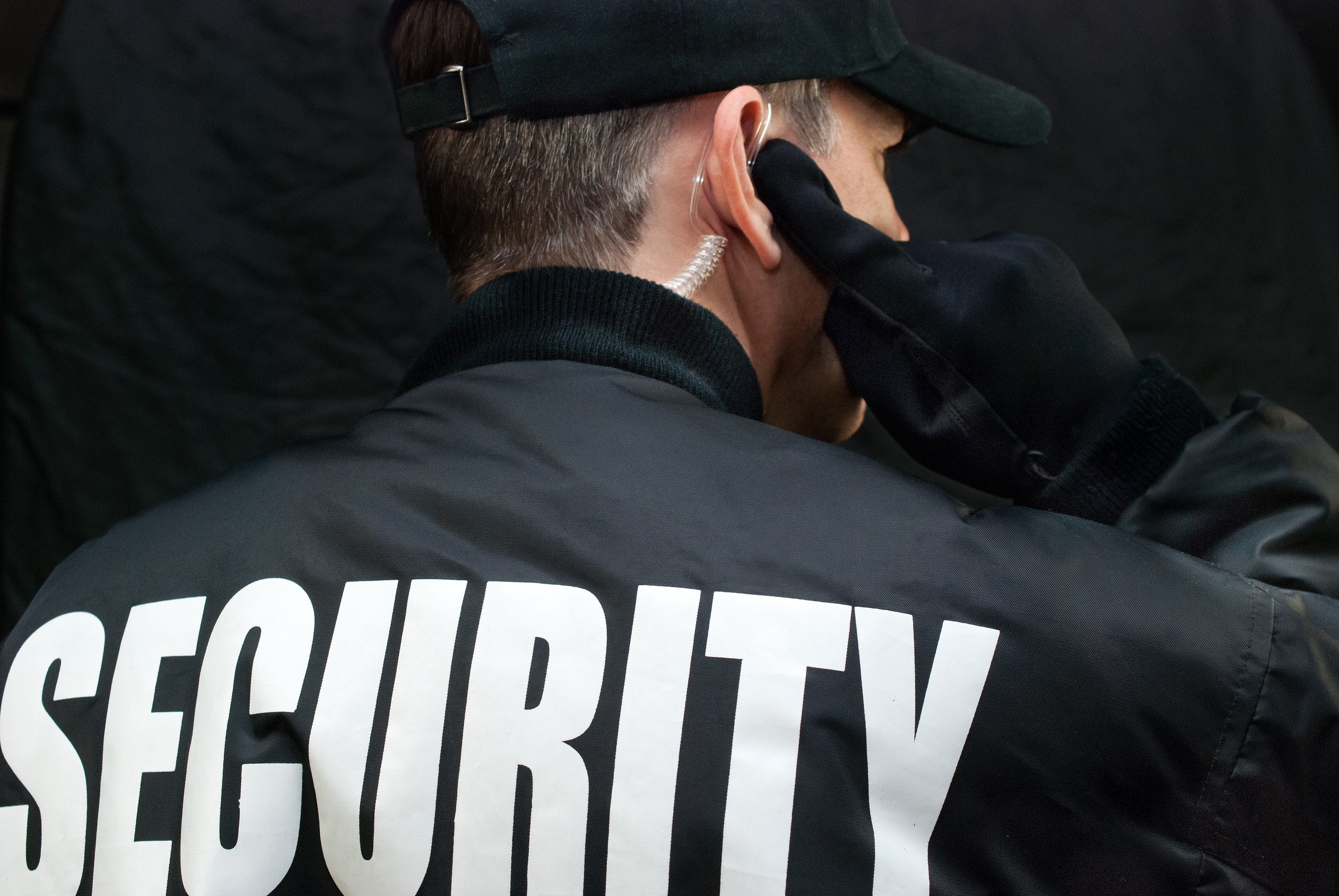 bigstock-Security-Guard-Listens-To-Earp-59468336