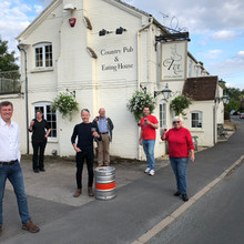 Action group celebrating the purchase of the pub in September 2020