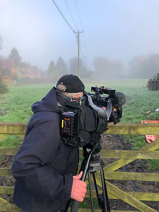 Ian the camera man looking into the fiel