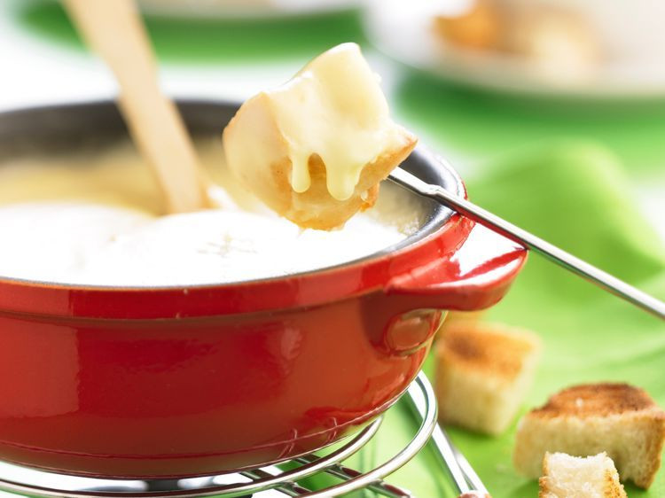 Swiss cheese fondue in a caquelon, swissness style.