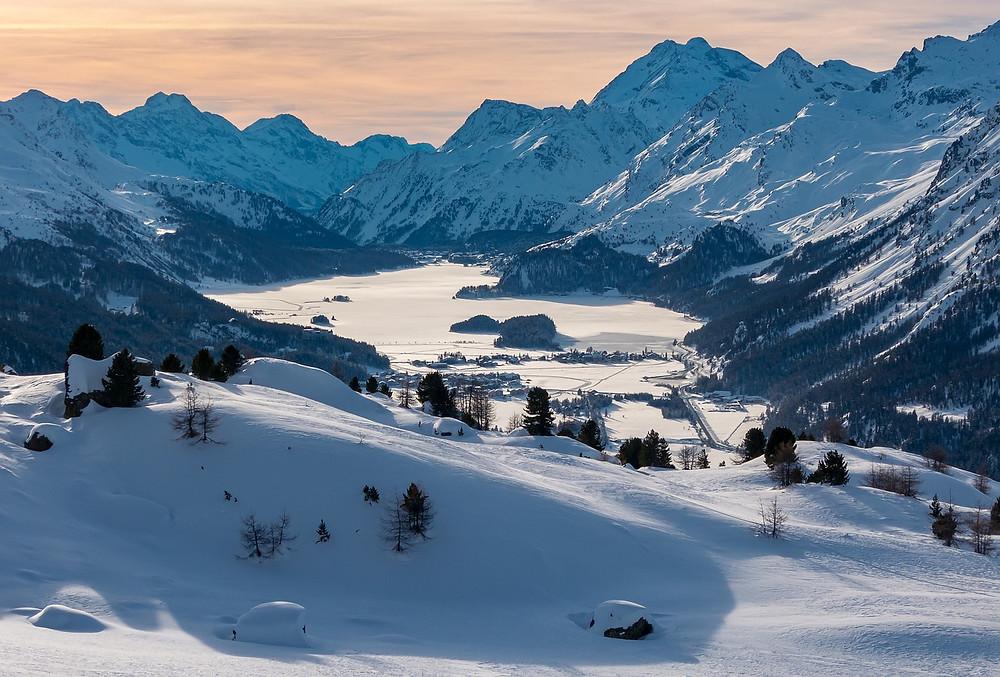 Engadin Swiss winter, snow and mountains, swissness lifestyle. Sports and cheese fondue. Switzerland.