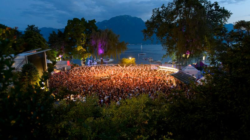 A summer night at Montreux Jazz Festival, a famous festival in the French-speaking Swiss riviera. Swissness lifestyle. Switzerland Multilingualism. Travel, swiss party.