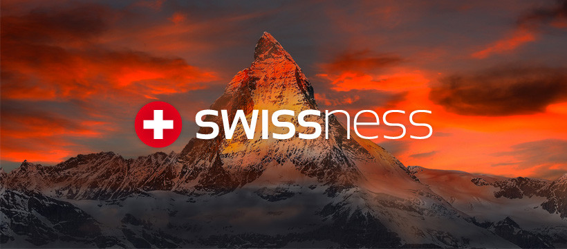 Swissness Norge As logo with Swiss mountains, Alps view.