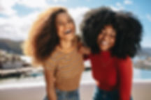 Two beautiful young women enjoying on th