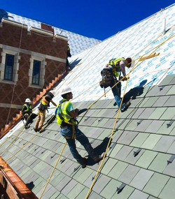 Roofers fixing a steep slope roof