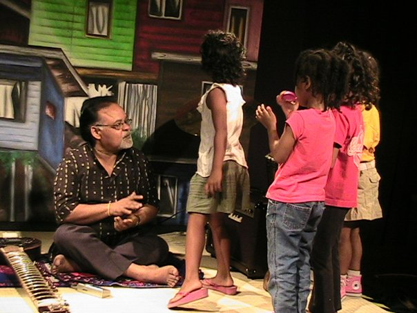 Mungal_directs_the_children_of_the_Petals_Media_workshop_with_their_beats._They_take_direction_very_