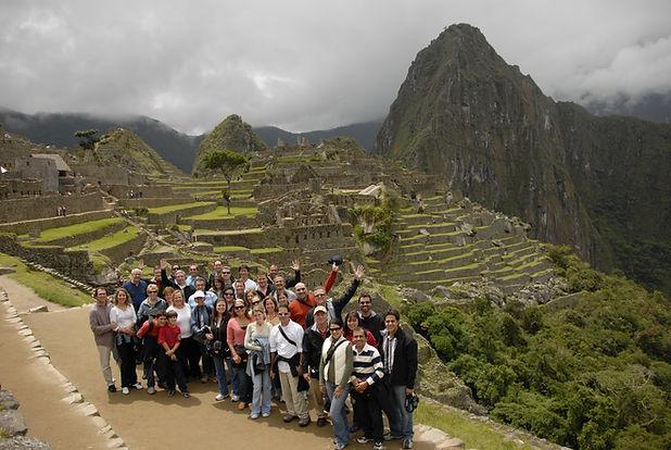 Group of people posing at Machu Picchu