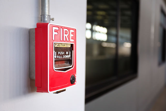 Fire alarm switch on the factory wall..j