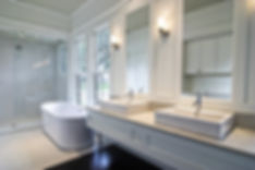 modern spacious white bathroom with dark