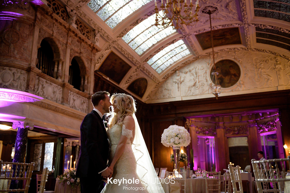This images shows a bride and groom in the Music Room of Thornton Manor. The wedding photo was shot by Keyhole Studios.