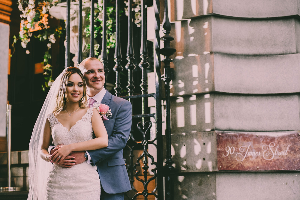 Bride and Groom on the steps of 30 James Street in Liverpool