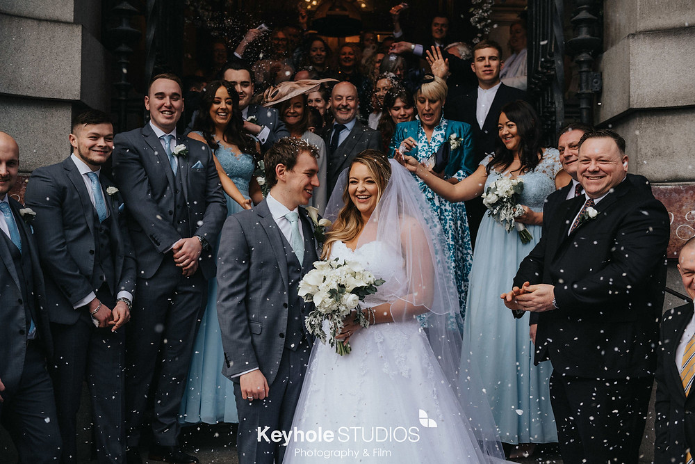 Wedding photograph taken by Keyhole Studios wedding photography & film at 30 James Street. confetti shot outside after the wedding ceremony.