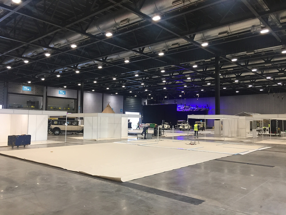 This image shows the exhibition space semi constructed. The space looks quite different in comparison to when the show is open