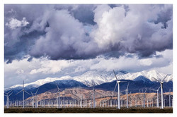 Windmills, Clouds and Snowcapped Mountains