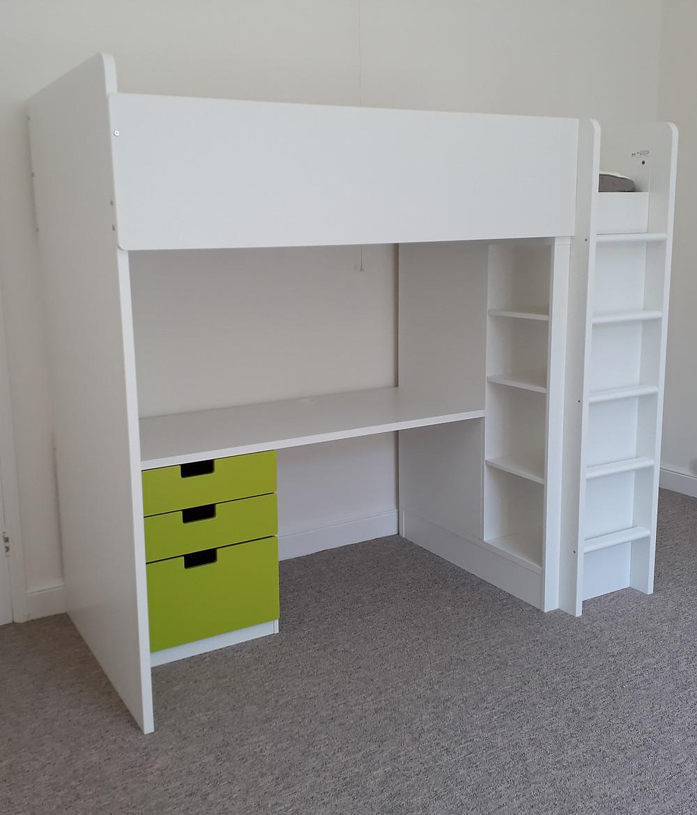 White IKEA Stuva loft bed with green drawers and wardrobe doors