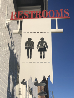 Love the restroom sign