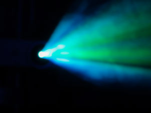 Blue-green rays of light through the smo
