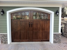 wood garage door with stone surround