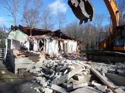 demolition of house with excavator