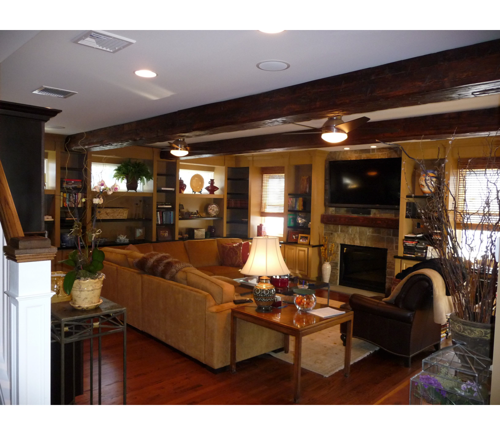 Faming room with wood beams and fireplace