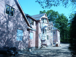 exterior brick installing during construction