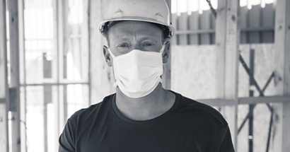 Construction worker wearing dust mask