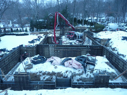 pouring concrete with pump trucks winter