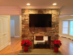 fireplace with stone and TV