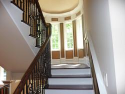 custom stair case with metal railings
