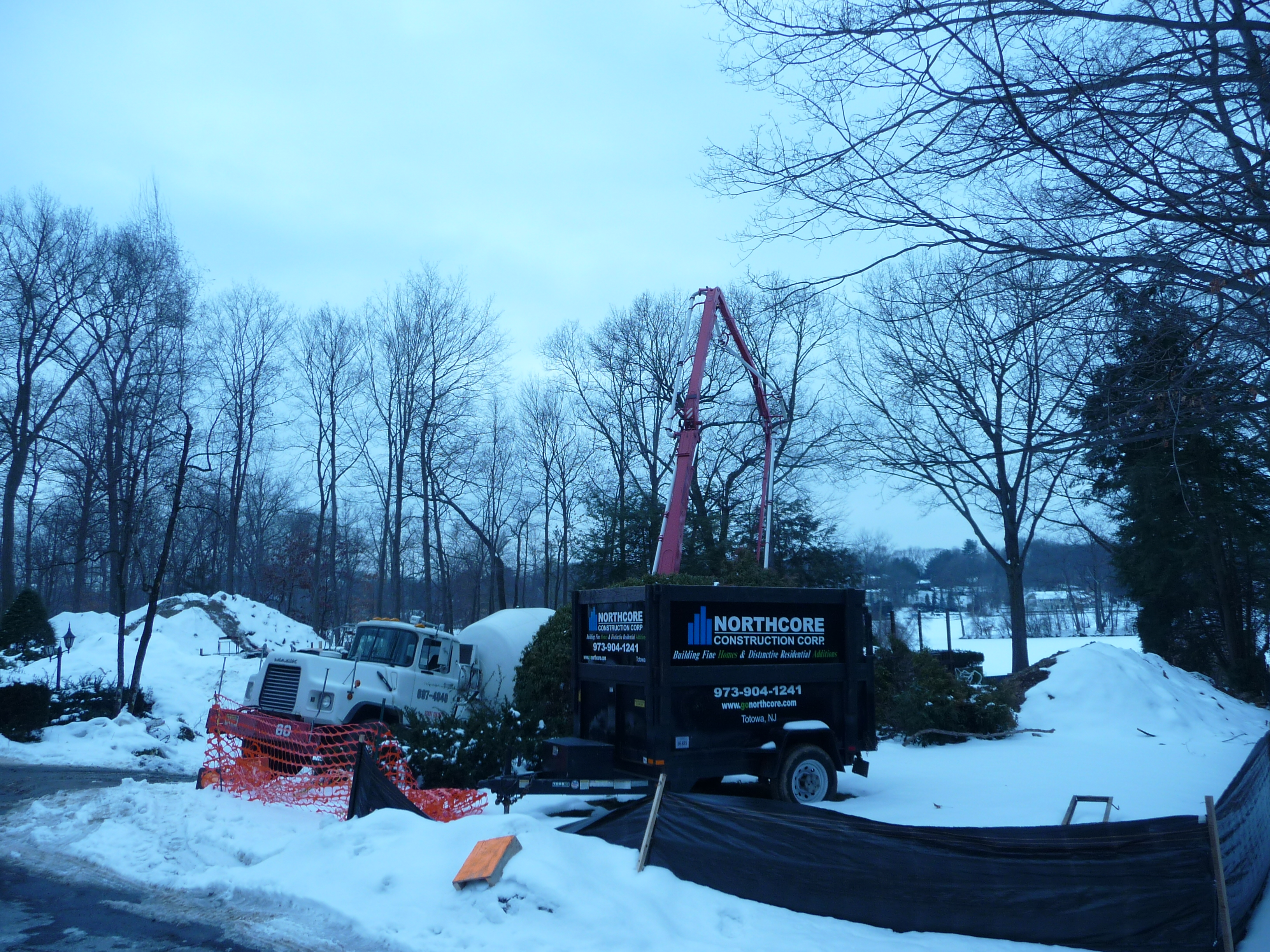 pouring concrete with pump trucks winter 2
