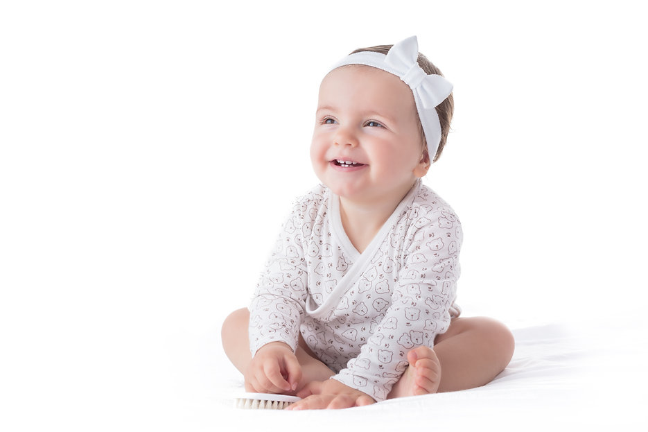Portrait of a smilling baby girl with ha