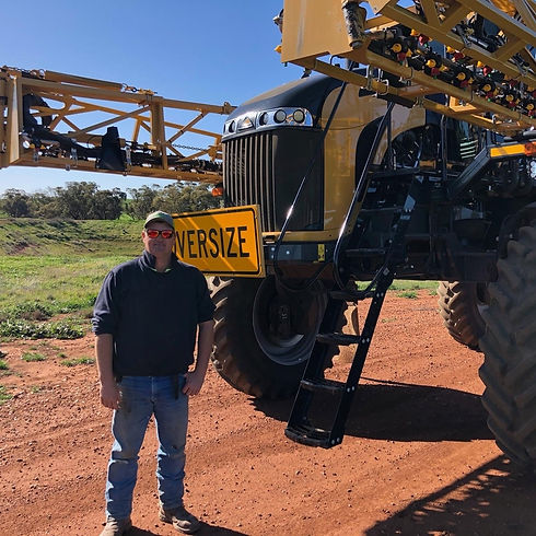 Todd Orrock in front of sprayer - Case S
