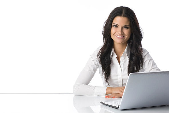 dark haired woman at laptop all white ba
