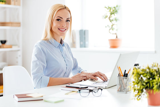 blonde lady sitting at desk working - co