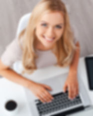 happy lady at computer looking up.jpg