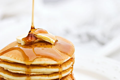 syrup-pouring-onto-a-stack-of-pancakes-1
