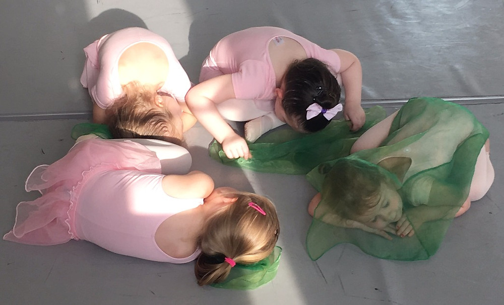 Preschool Dancers doing their best cocoons as they learn the Butterfly Dance for the first time!