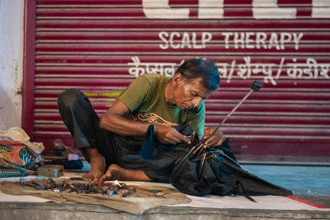 Umbrella repairer, CR Park, New Delhi